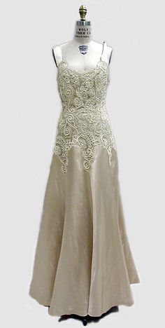 Chanel gown in slipper satin with reembroidered lace bodice, circa 1939-1940