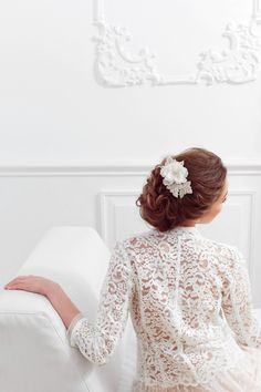 Introducing Primrose, a classic hair comb made from a white silk flower with white stamens and a Swarovski rhinestone in the middle, surrounded by French embroidery leaves embellished with Swarovski crystals and seed beads. with Mandarina Models Romania​, Alexandra Crăescu,Make-up Artist​, Sorin Stratulat​ #mbridal #bride #accessories #accesoriimirese #lovehimbeforeyousayyes