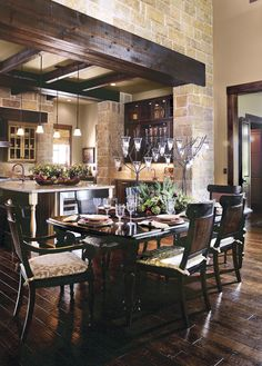 love the dark wood flooring and cozy feel of this room