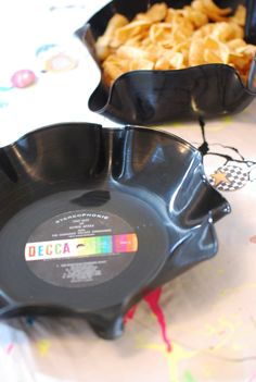 40th Birthday Party Deets | Tangarang - Some really cute 80s ideas.  Melted records for candy bowls, Blow Pop martinis...