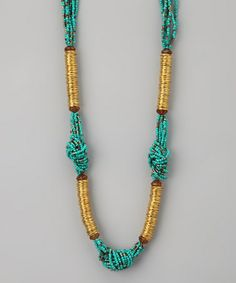 Take a look at this Turquoise & Gold Beaded Knot Necklace by ZAD on #zulily today!