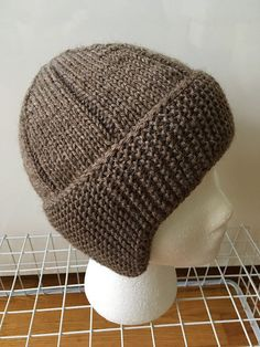 The construction of this hat was inspired by one pictured in a magazine published around Knitting the headband side to side provides a double layer of garter stitch to keep the ears warm, and allows for easy shaping of the earflaps. The edges of the Baby Knitting Patterns, Knitting Blogs, Easy Knitting, Double Knitting, Loom Knitting, Knitting Stitches, Knit Or Crochet, Crochet Hats, Knitting Accessories