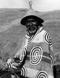 """Plate LIX of Duggan-Cronin's """"The Bantu Tribes of South Africa - The Suto-Chuana Tribes"""" makes reference that the function of the hat was to deflect rain and that a persons blanket was drawn up around the neck in wet weather."""