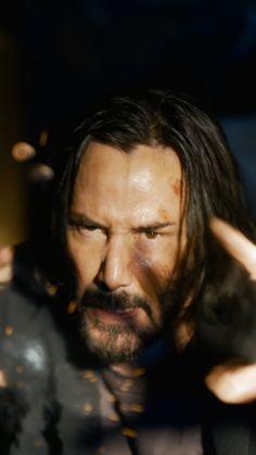 Keanu Reeves In The Matrix Resurrections 4K Ultra HD Mobile Wallpaper.
