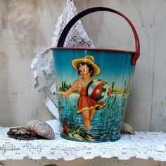 And of course a great sand pail for building sand castles!  SALE 15  off Vintage early 1900s sand pail tin by oldkeysvintage, $153.00