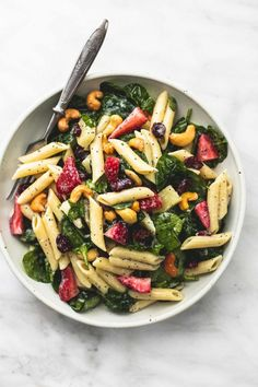 Sweet and tangy strawberry spinach pasta salad with orange poppyseed dressing is. - Sweet and tangy strawberry spinach pasta salad with orange poppyseed dressing is the perfect potluc - Pasta Salad With Spinach, Pasta Salad Recipes, Soup And Salad, Penne Pasta Salads, Spinach Salads, Taco Salads, Crab Salad, Spinach Recipes, Tortellini