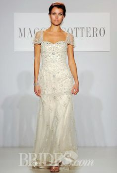 "Brides.com: Maggie Sottero - Spring 2014. ""Janelle"" beaded tulle and satin A-line wedding dress with a sweetheart neckline and illusion short sleeves, Maggie Sottero"