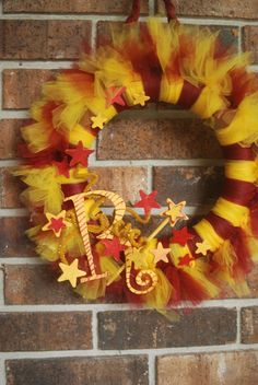 I LOVE the look of this Gryffindor wreath.  The only things I would change: Do 1/4 of the wreath in each of the house colors, and for the letters do either an H for Hogwarts, or a lightning bolt.  I would hang this on my door for Harry's birthday every year. (@Jill Whitney and @Claire Shaw, I thought you guys would love this too.)