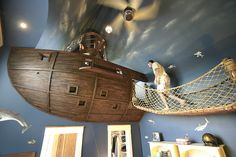 Designer Steve Kuhl created this one-of-a-kind pirate ship bedroom for a client's six year old son. It features an incredible floating ship, rope bridge, and secret 55 foot slide!
