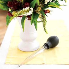 Instead of messing up the arrangement, or dumping filthy water, use turkey baster