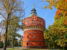 """One unknown fact about Poland is that here, vampires often conceal their havens as water towers. No-one else would design them to look THAT cool, let's be honest. Poland Facts, Visit Poland, Tank I, Water Tower, My Heritage, Lighthouse, Places To Visit, Island, Travel"