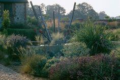 Love the sculpture---very whimsical, Bury Court Front Garden, photo Clive Nichols. Gardenista