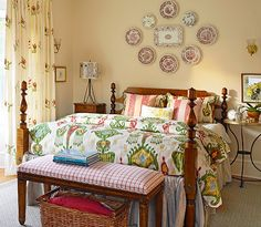 Colorful fabrics and vintage-style and furnishings reinforce the traditional look of this master bedroom.