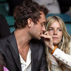 Sharing a nibble... Jude Law and Sienna back in the day - fun and reckless lovers