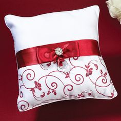 You are sure to love the elegance of this Red and White Ring Bearer Pillow. Rich red and white color combination is sure to make you wedding even more beautiful.