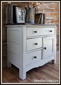 White chalk paint on a dresser with an espresso-stained top.