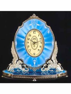 Silver gilt and enamel, eight-day going timepiece, designed as a cheval glass. Plojoux, circa 1910