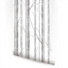 Birch tree peel and stick stick fabric wallpaper. This re-positionable wallpaper is designed and made in our studios in New Jersey. The designs are printed onto an adhesive backed fabric that can be r