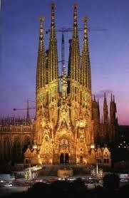 La Sagrada Familia in Barcelona by night is a must. The whole church is lit up by giant lights that makes it seem like it's glowing!