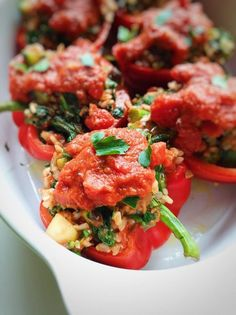 Vegan Italian Stuffed Peppers! Italian stuffed peppers get a vegan twist. This recipe uses a super simple homemade roasted tomato sauce that is to-die-for. Peppers are filled with all good-for-you-goodies, including walnuts, olives, zucchini, broccolini, and brown rice!