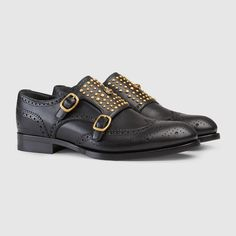 """$1,250 Gucci Queercore Brogue Double Monk Strap - SOLD by GUCCI - A double-strap monk style shoe mixes traditional brogue details with a punk aesthetic. Rounded studs and metal feline head embellish the front. Black leather with gold-toned hardware Brogue details Gold embroidered bee detail at the back Leather sole Double buckle strap closure .75"""" heel height Made in Italy Affiliate Link"""
