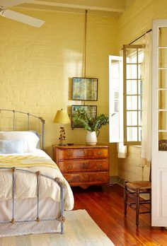 Country Style Bedroom with Painted Brick Walls