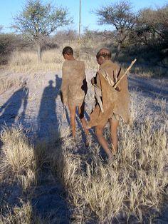 Bushmen - afternoon walk and shadows getting longer - Ghanzi, Botswana