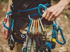 40985720-Close-up-of-female-rock-climber-wearing-safety-harness-with-quickdraws-and-climbing-equipment-outdoo-Stock-Photo.jpg (1300×973)