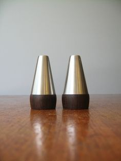 Danish Modern Stainless / Wood Salt and Pepper Shakers. via Etsy.