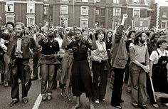 """A Rock Against Racism rally, London, England, United Kingdom, 1977, photograph by Syd Shelton. RAR was established following musician Eric Clapton's 1976 declaration during a concert to """"get the foreigners out, get the wogs out, get the coons out"""" and chanting the National Front's slogan """"Keep Britain White!"""" followed shortly by pop singer David Bowie's use of the Nazi salute in public and his statement, """"Hitler was one of the first rock stars."""""""