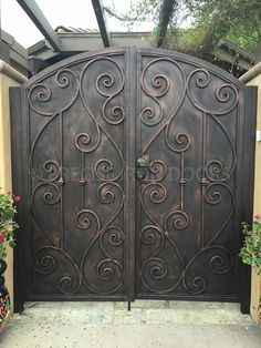 Iron Gates  Iron gates are often the first element of a person's home that guests see as they enter. While some are simply satisfied with a gate that is functional, others realize the importance of making a first impression with a strong yet elegant aesthetic. We invite you to browse