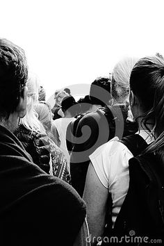 Photo about A high contrast black and white image of people standing in line from the perspective of standing in line looking at people`s backs. Image of black, peoples, looking - 90706009