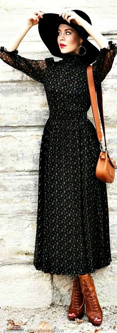 Street style - Ulyana Sergeenko. Love the tan boots and bag with modest prairie style dress.