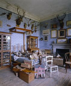View of Sir Vauncey Harpur's Bedroom at Calke Abbey with Periwinkle colored walls.