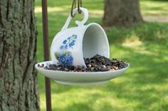 Old Teacup  Saucer...re-purposed into a sweet birdfeeder  hung from a shepherds hook!