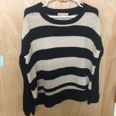 Long sleeve sweater Beautiful long sleeve sweater with stripes. Shorter in the front, and longer in the back. Barley worn. Sweaters Crew & Scoop Necks