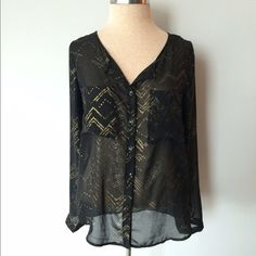 Olive & Oak black and gold sheer top Pre-owned in great condition. No rips or stains. Size small.  Measurements: Underarm to underarm is approximately 19 inches. Length from back of neck to bottom of hem is approximately 25 inches. Material: 100%  polyester. Olive & Oak Tops Blouses