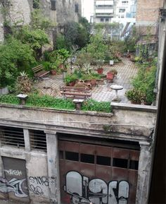 A hidden garden in the rooftop of an old building at the corner of Filopoimenos and Riga Ferraiou streets in the city of Patras in Greece