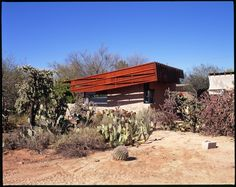 A steel roof hangs over the two southern facing walls, shielding them from the sun, keeping the earthen walls cool throughout the day. Natural pressed earth blocks, corten steel, and board-formed concrete make for a very natural and rough texture that blends perfectly with the surrounding desert.