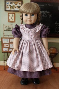 Kirsten is the first to get a new dress for fall. She will be ready when school starts. Her dress is made from the Keepers Dolly Duds pattern