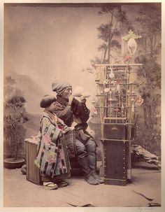 Hand Colored Photographic Images of Meiji Era Japan -  Toy vendor.