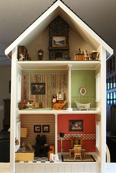 Doll house made of a two shelf book case.