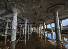 Packard Auto Plant-Detroit. 8 years to construct the 3,500,000 sq ft manufacturing plant, completed in 1911 on 40 acres of land. Most of the factory closed in 1958, with businesses using the property thru the 1990s and dwindling to the final tenant who packed up in 2010. The crumbling behemoth has been a scrapper's paradise, a home for vagrants, a canvas for artists, and site of a tiger escape. Bought in 2013 for $405,000, demolition and reconstruction efforts have begun.  by Brook Ward