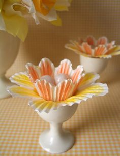 What vibrantly cheerful yellow and pale orange hued cupcake liner flowers. #Easter #cupcake #liner #wrappers #food #eggs #candy #flowers #DIY #crafts #decorations