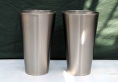 2 brushed stainless steel planters 30cm dia x 55cm tall Good condition