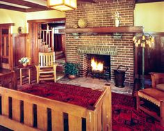 The long neglected Arts and Crafts (1910) Mead house by Louis B. Easton was still basically intact.  We restored every surface inside and out. This is restored living room with original fireplace.