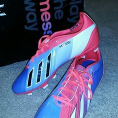 Messi Soccer Cleats Vibrantly colored Messi/Adidas soccer cleats!! Never worn, due to the wrong size. Fits a Women's size 8 1/2. The only issues with these great sport ready shoes is a small black scuff mark on the front of the right cleat, and my name in the shoes. Adidas Shoes Athletic Shoes