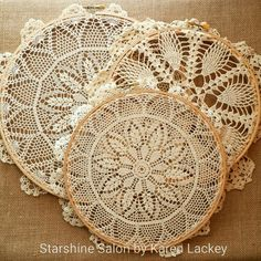 Vintage doilies in wooden hoops, by Karen Lackey