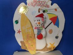 surfboard snowman sand dollar ornament by tuttomare on Etsy, $8.50