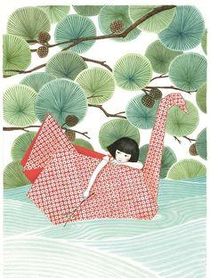petite fille sur un bateau en forme de grue origami